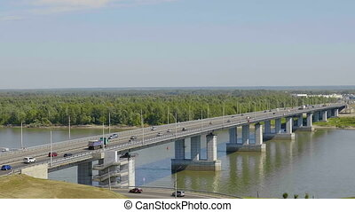 Car traffic on bridge in Barnaul on August.