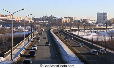 Car traffic on bridge. Winter city Omsk. Timelapse