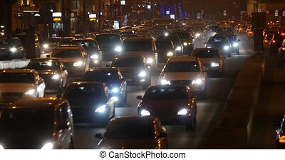 car traffic on busy street at night