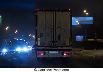 car traffic on night winter highway blur