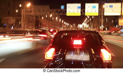 Car traffic on the night streets of the city