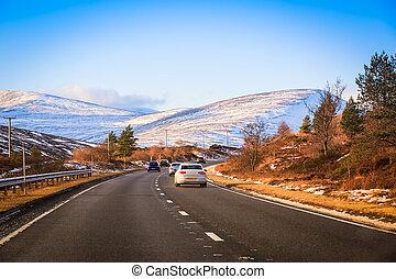Car travel - traffic on a road through Scotland