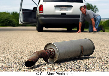 Car Trouble Series 1 - A man kneals on the ground by his car...