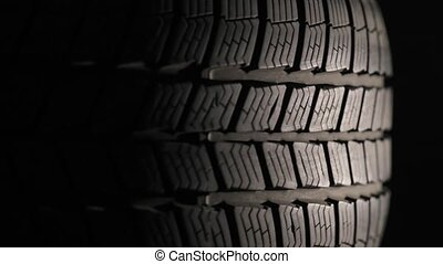 Car Tyre Spinning - Spinning tire of a car, dark background,...