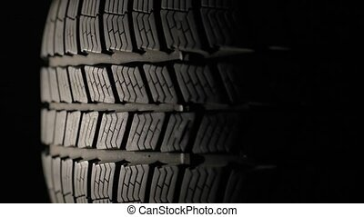 Car Tyre Strating To Spin - Spinning tire of a car, dark...