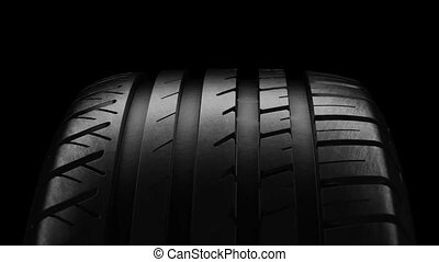 Car tyre summer wheel rotate motion isolate black - Car tyre...