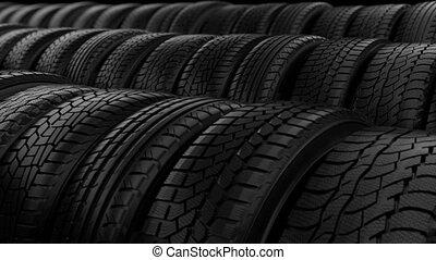 Car tyre wheels storage night black light dolly camera shot,...