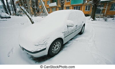 Car under snow - A car covered with snow