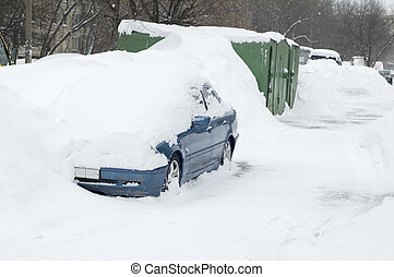 car under snow in city