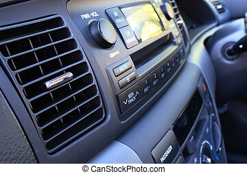 Car vent and radio - Car air conditioning vent and radio