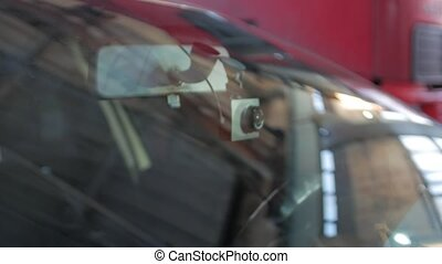 Car video recorder through the windshield push in camera movement