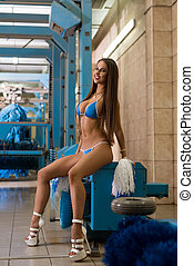 Car wash. Brunette looking at camera coquettishly