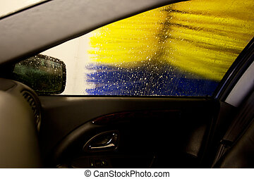 Car Wash Brush - An automatic car wash brush, washing the...