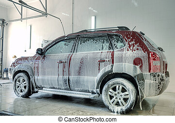 car wash - car covered in foam at the carwash