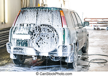 Car wash foaming wash. The car is backwards.