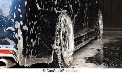 Car wash - Bangkok, Thailand - June 28, 2015 : Blue car...
