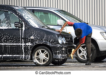 Car Wash - Image of a commercial car washer in action.