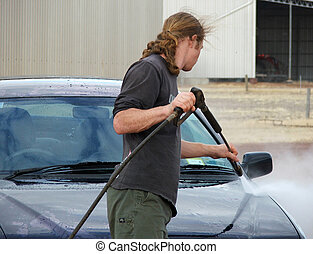 car wash - man washes his car with a preasure cleaner
