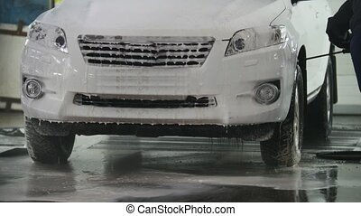 Car washing - a SUV car in the suds - car service, close up