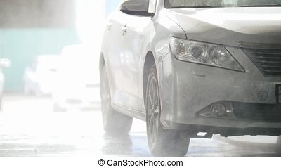 Car washing in auto service - small business, telephoto