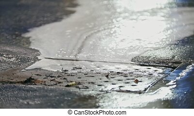 Car washing - soap foam drains to sewer, close up