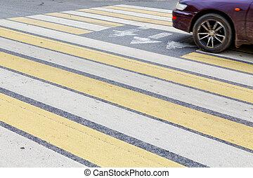 Car wheel at a pedestrian crossing
