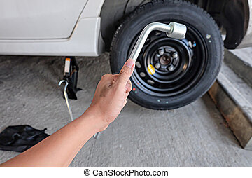 Car wheel changed by Wrench