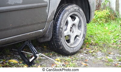 Car wheel changing after disruption - Changing a car wheel:...