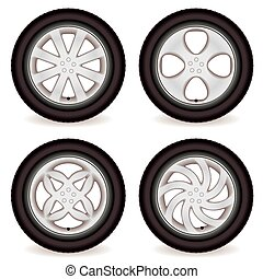 Four car tires with alloy wheels of different designs