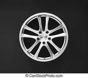 Car wheel hub isolated on black