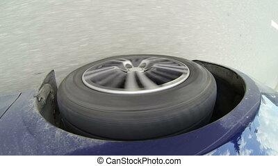 Car wheel rolling on asphalt
