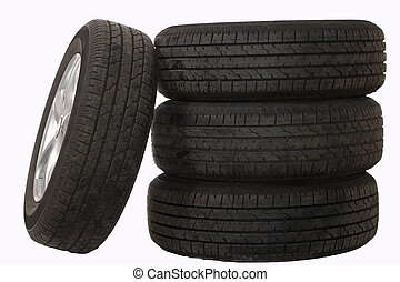 A photo of modern car wheels isolated over white background.