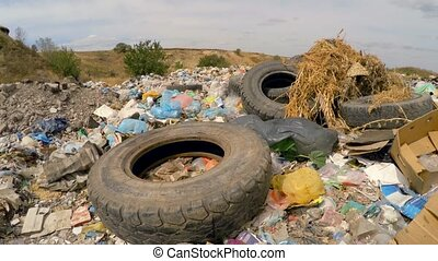 Car Wheels Among Garbage Dumped Into Heap At Landfill In Ukraine