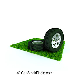 car wheels on a lawn with a green bright grass