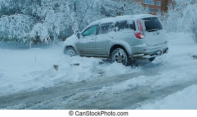 Car wheels riding on deep snow at winter season