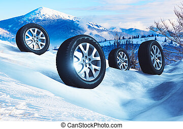 Car wheels with offroad winter tyres on snow