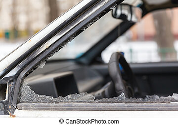 car window smashed by a thief, the slums of Russia
