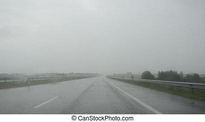 car windscreen view rain - Front driving automobile...