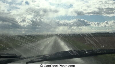 car windscreen viper in motion. Cleaning car window in rainy...