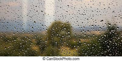 Car windscreen with rain drops background