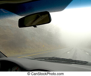 View from the passenger side of a foggy day on the highway.