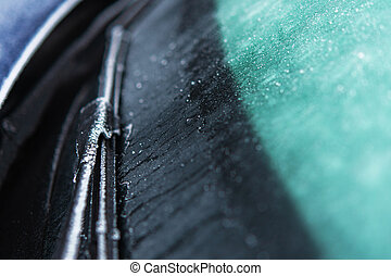 Car Windshield and Wiper Covered by Frost and Ice