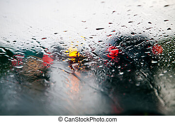 Car windshield in traffic jam during rain