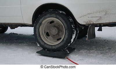 Car with a jack to lift the rear wheel