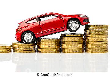 car with coins - a car standing on euro bills. cost of ...