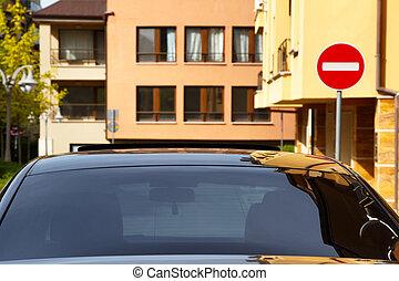 Car with dark tinted windows in an urban street below...