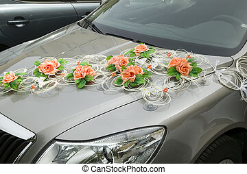 Car with decorations from flower for driving bride and groom