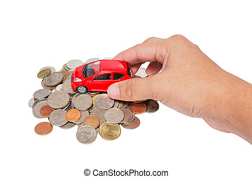 Car with hand stand on a pile of coins