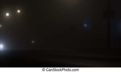 car with headlamps driving on a foggy road at night, poor...
