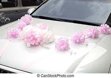 Car with plastic decorations for driving bride and groom